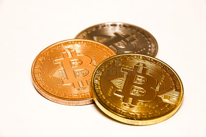 Bitcoin gold, silver and bronze coin. Cryptocurrency concept. Isolated on the white background royalty free stock photography