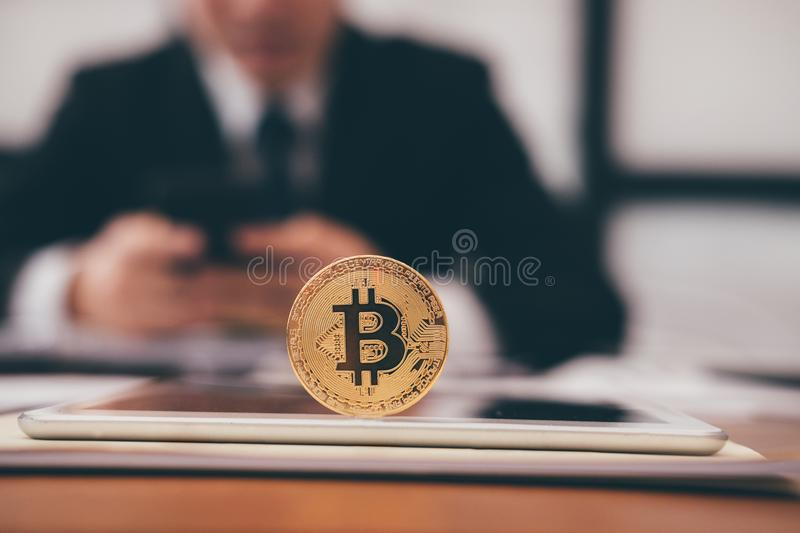Bitcoin golden coin on tablet. symbol of crypto currency digital royalty free stock images