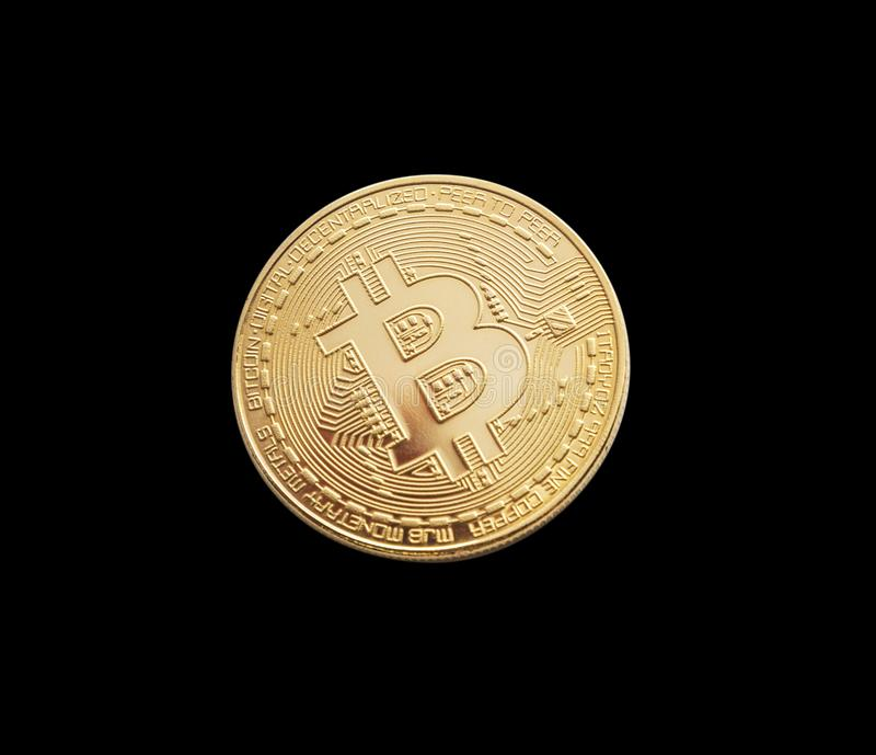 Bitcoin. Golden bitcoin isolated on black background royalty free stock image