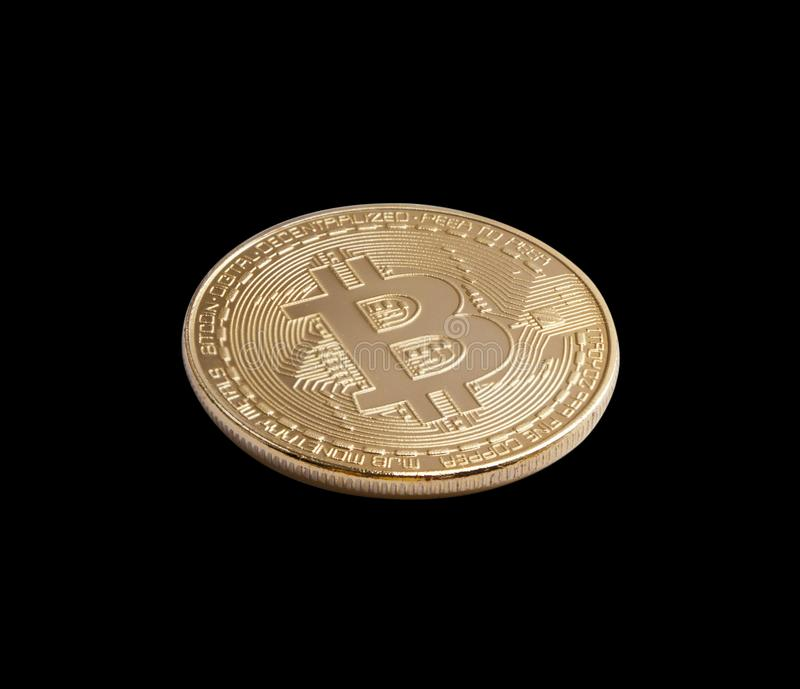 Bitcoin. Golden bitcoin isolated on black background stock photo
