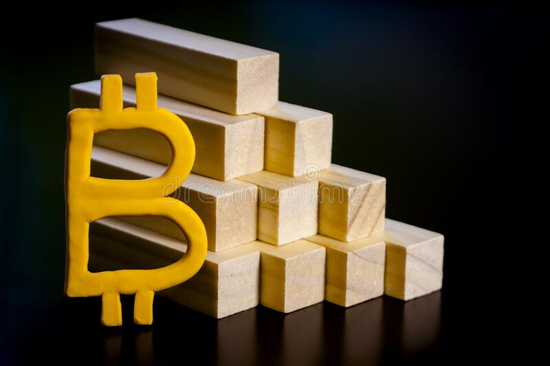 Bitcoin handmade sign and a wooden pyramid stock photography