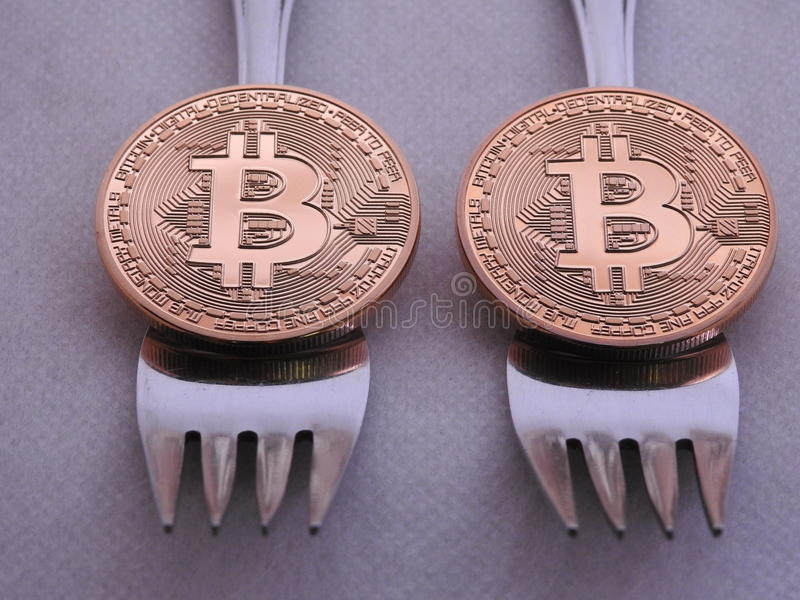 Bitcoin hard-soft fork. Bitcoin hard or soft fork to implement new rules in the block chain royalty free stock photo
