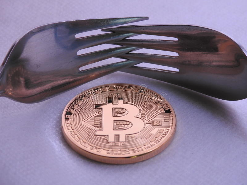 Bitcoin hard-soft fork. Bitcoin hard or soft fork to implement new rules in the block chain stock photos