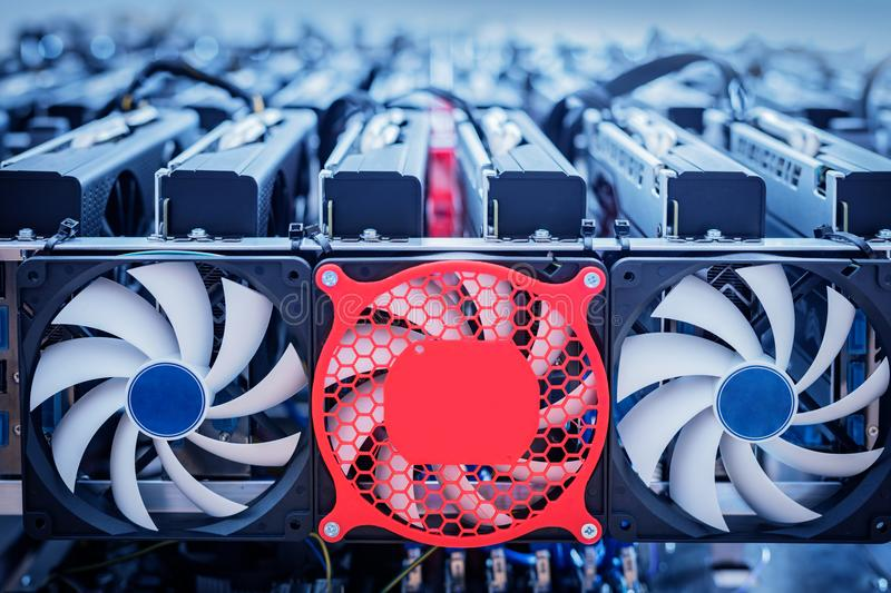 Bitcoin industry hardware. Cryptocurrency mining. Big electronic device with fans and wires royalty free stock photo