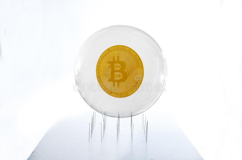 Bitcoin inside a bubble over a needles bed simulating the fragility of this speculative currency stock illustration