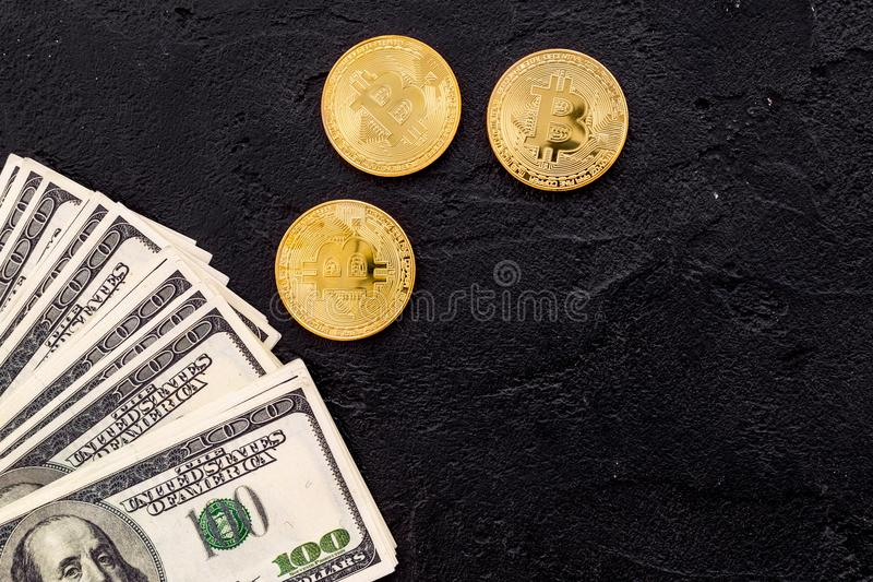 Bitcoin with international currency banknotes on black background top view space for text royalty free stock images