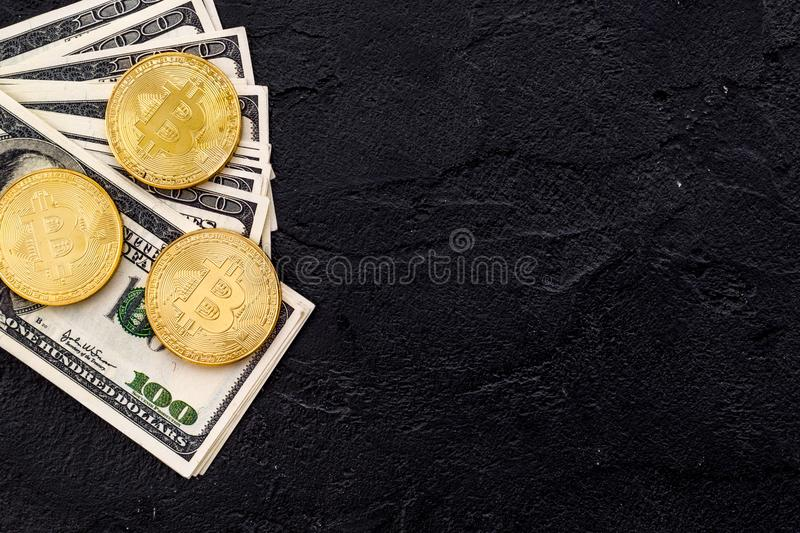 Bitcoin with international currency banknotes on black background top view space for text royalty free stock image