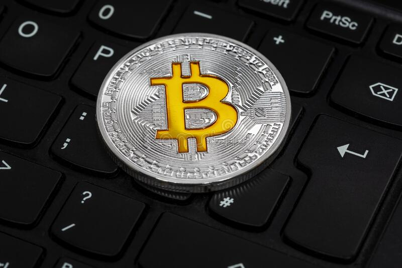 Bitcoin keyboard. Bitcoin, background on a black computer laptop keyboard stock photos
