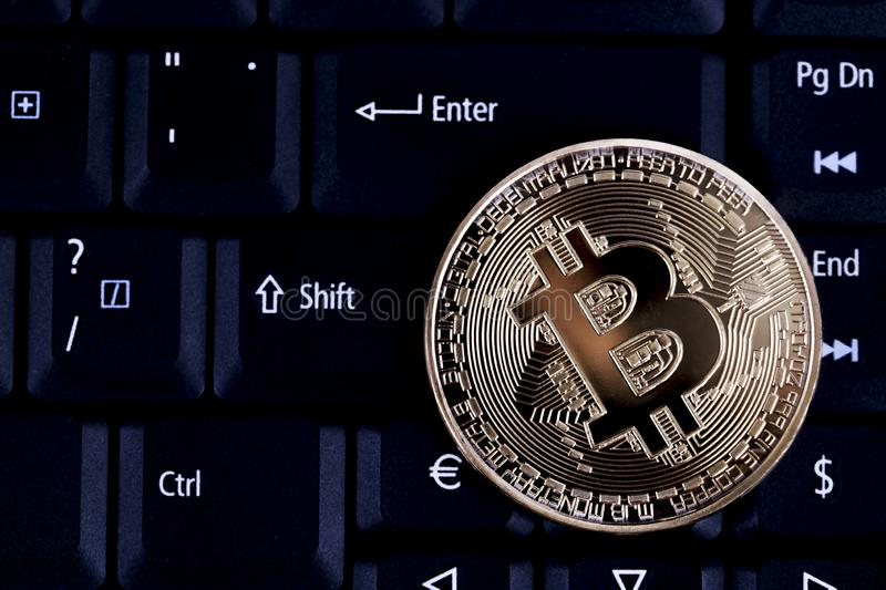 Bitcoin on keyboard, Bitcoin is Electronic currency Internet finance royalty free stock image