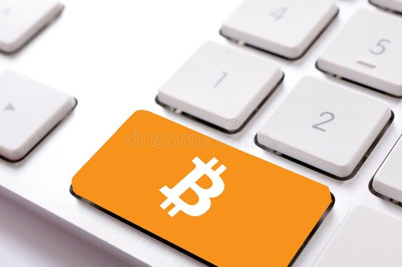 Bitcoin on keyboard. Bitcoin sign on the keyboard royalty free stock photos