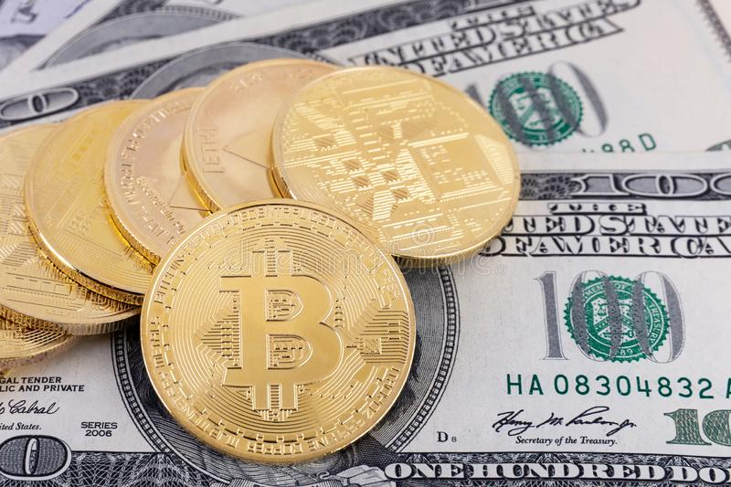 Bitcoin, Litecoin and Ethereum crypto currency coins lying on american USD dollars.Exchange bitcoin for a dollar.Concept of tradin royalty free stock image