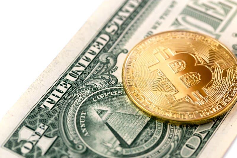 Bitcoin logo och en dollar arkivfoto