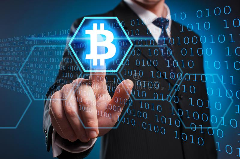 Bitcoin. A man in a suit and tie clicks the index finger on the stock image