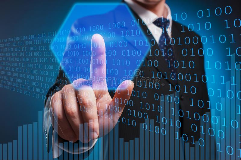 Bitcoin. A man in a suit and tie clicks the index finger on the stock photos