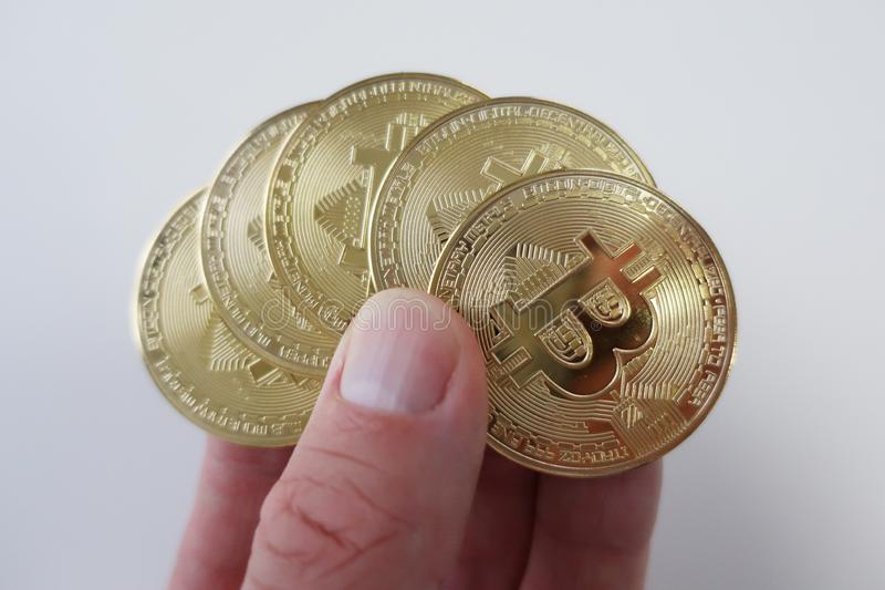 Cryptocurrency coins presented in a hand stock photos