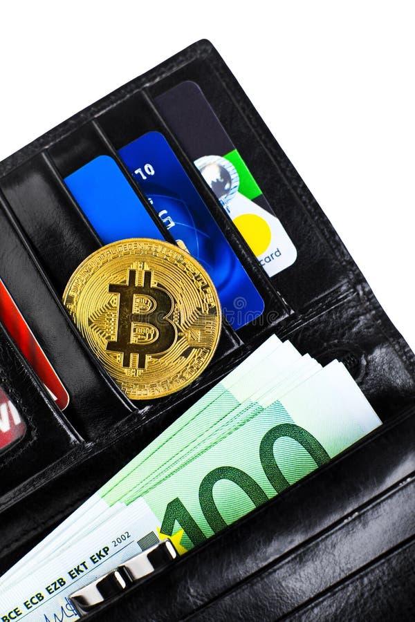 Bitcoin moneta w otwartym portflu zdjęcie stock