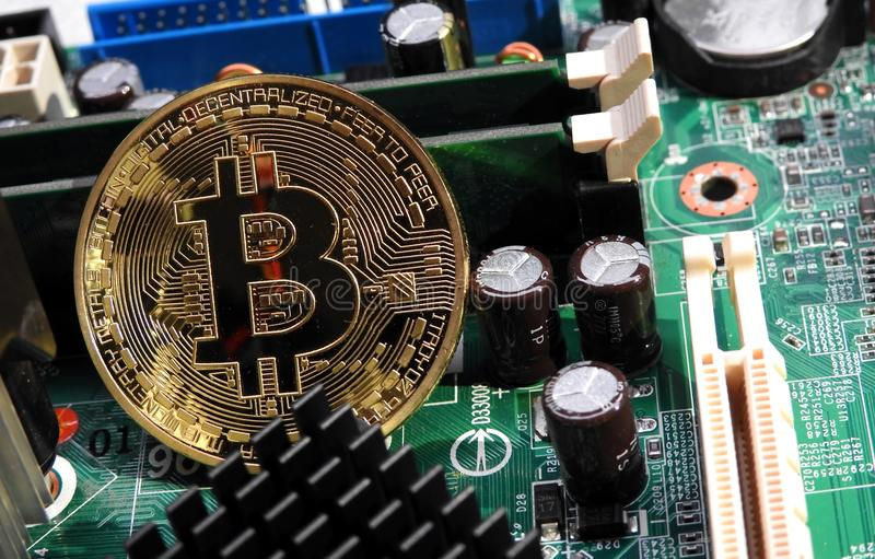 Bitcoin on motherboard. A close up of bitcoin on the motherboard royalty free stock photography