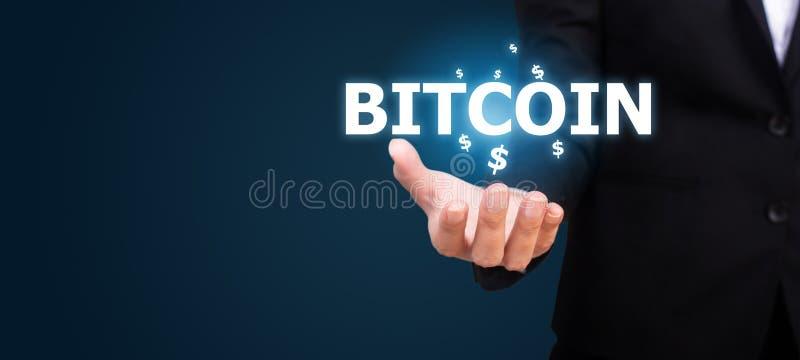 Bitcoin nella mano dell'affare Concetto di Bitcoin immagine stock libera da diritti