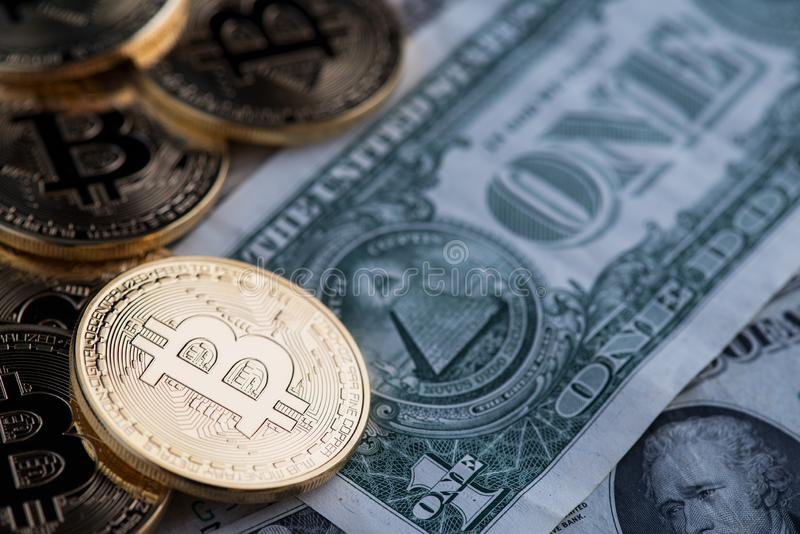 Bitcoin new virtual money and banknotes of one dollar. stock photography