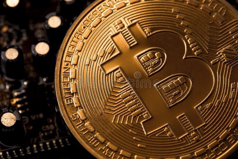 Bitcoin och moderkort arkivbilder