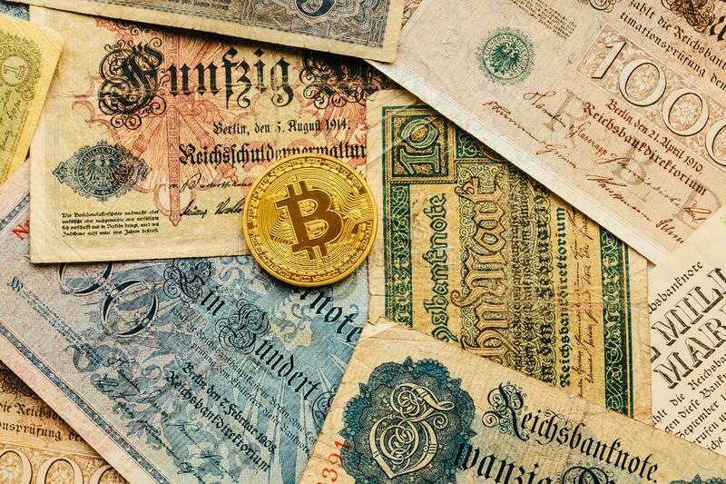 Bitcoin with old deutsch money. Inflation. Cryptocurrency concept background. Closeup with copy space. stock photo