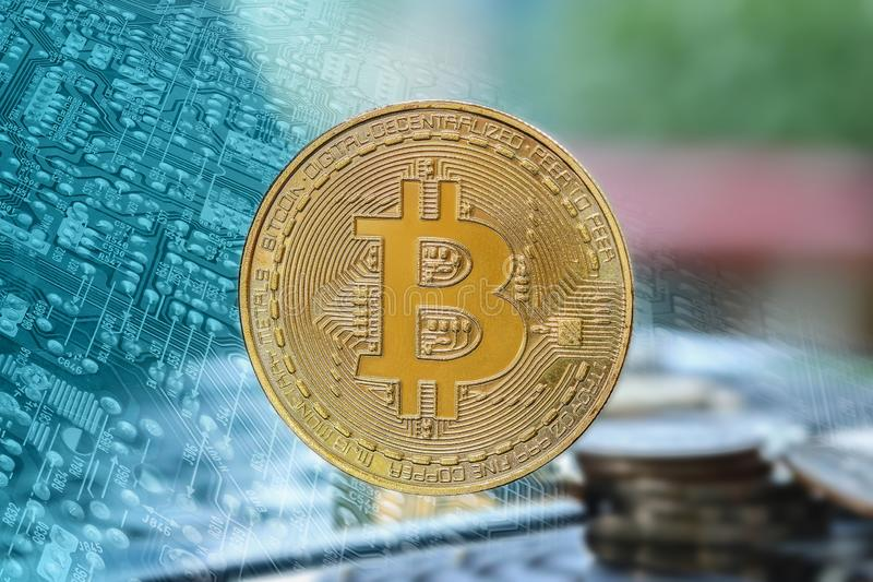 Bitcoin On the electronic circuit backgroundTechnology success concept royalty free stock image