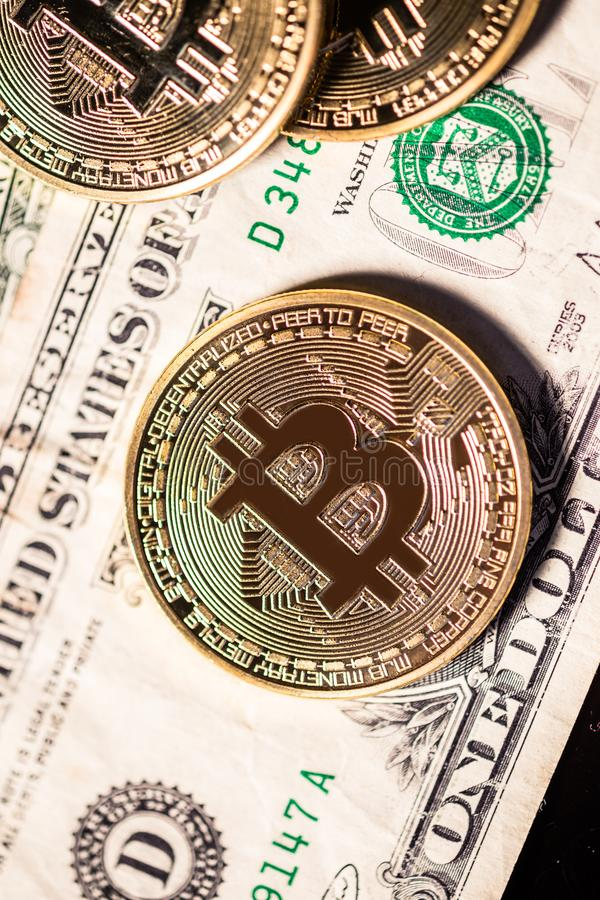 Bitcoin on outdated dollar bills stock photography