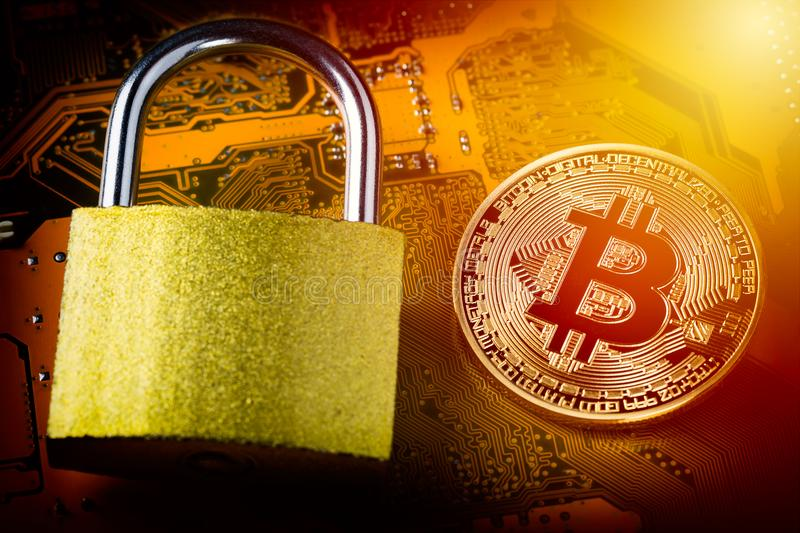 Bitcoin with padlock on computer motherboard. Crypto currency Internet data privacy information security concept. Focus on bitcoin.  stock image