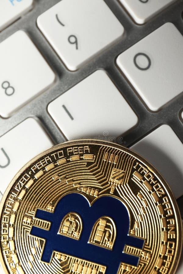 Bitcoin on PC keyboard, closeup stock image