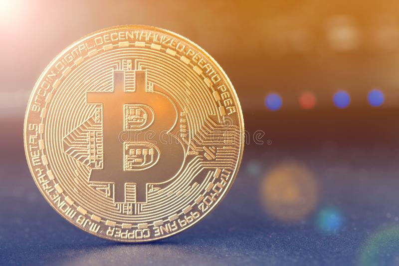 Bitcoin and Physical bit coin. Digital currency. Cryptocurrency. Golden coin with bitcoin symbol. Bitcoin and Physical bit coin. Digital currency stock photos