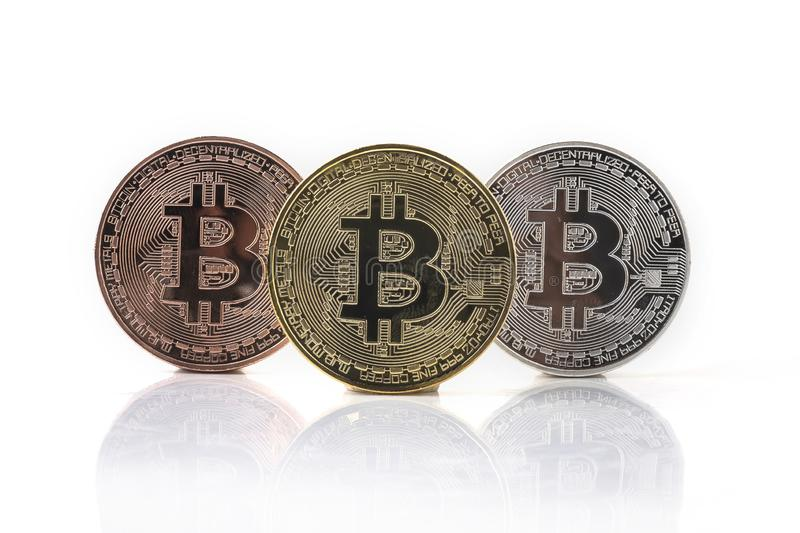 Bitcoin. Physical bit coin. Digital currency. Cryptocurrency. Golden coin with bitcoin symbol isolated on white background. Bank banking btc business cash stock photos