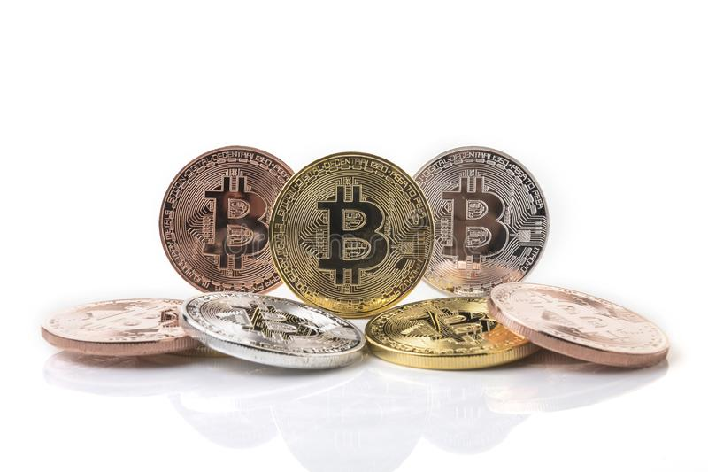 Bitcoin. Physical bit coin. Digital currency. Cryptocurrency. Golden coin with bitcoin symbol isolated on white background. Bank banking btc business cash royalty free stock photo