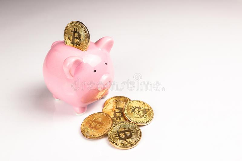 Bitcoin and pink piggy bank stock image