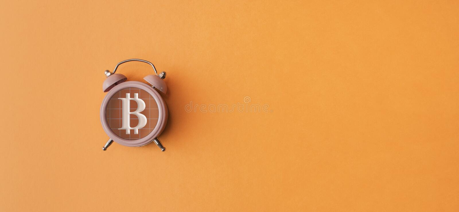 Bitcoin sign in the alarm. On yellow background stock image