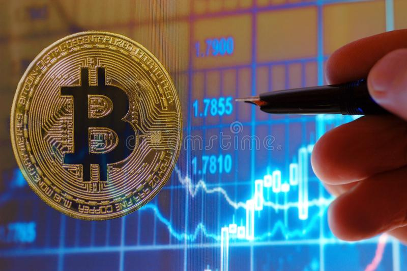 Bitcoin and stock chart royalty free stock image