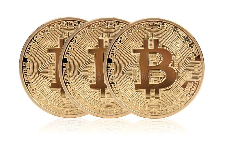Bitcoin trois d'or photographie stock libre de droits
