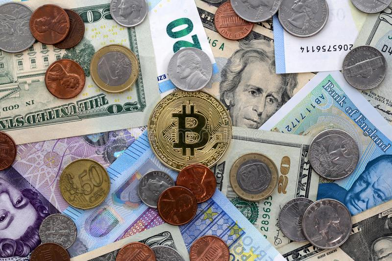 Bitcoin US dollars UK Pound EU Euro. Bitcoin golden coin on United States US twenty dollar bill $20 and cents, United Kingdom Pound sterling banknotes and EU royalty free stock image