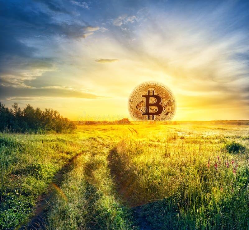 Bitcoin w postaci powstającego słońca zdjęcia stock