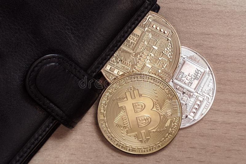 Bitcoin in the wallet stock image