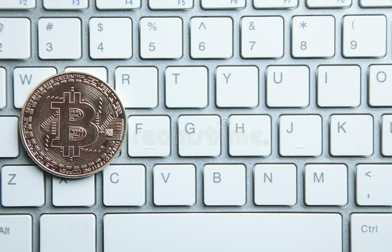 Bitcoin on white computer keyboard. Technology, Commercial and F stock images