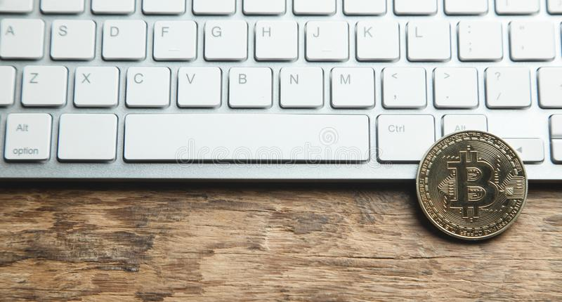 Bitcoin on white computer keyboard. Technology, Commercial and Finance concept royalty free stock photography
