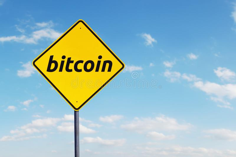 Bitcoin word on the yellow signboard. Image of bitcoin word on the yellow signboard under blue sky stock photography