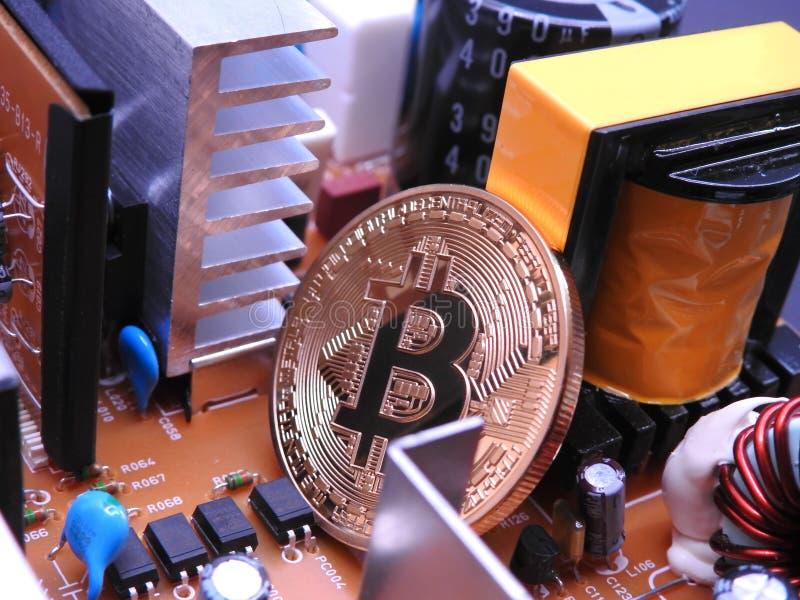Bitcoin y tablero de poder imagen de archivo