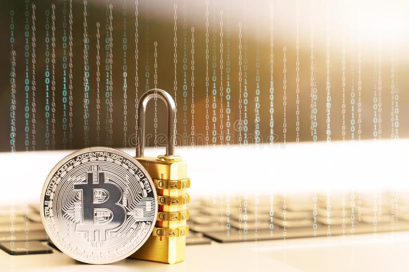 BitcoinBTC coin with padlock lying on computer background. stock image