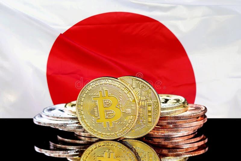 Bitcoins和日本的旗子 免版税库存图片