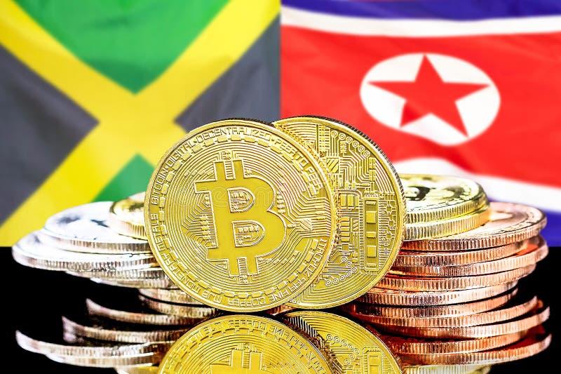 Bitcoins auf Flagge Jamaikas und Nordkoreas Hintergrund lizenzfreies stockfoto