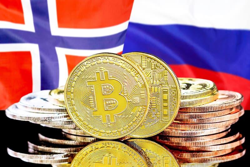 Bitcoins auf Norwegen- und Russland-Flagge Hintergrund lizenzfreies stockbild