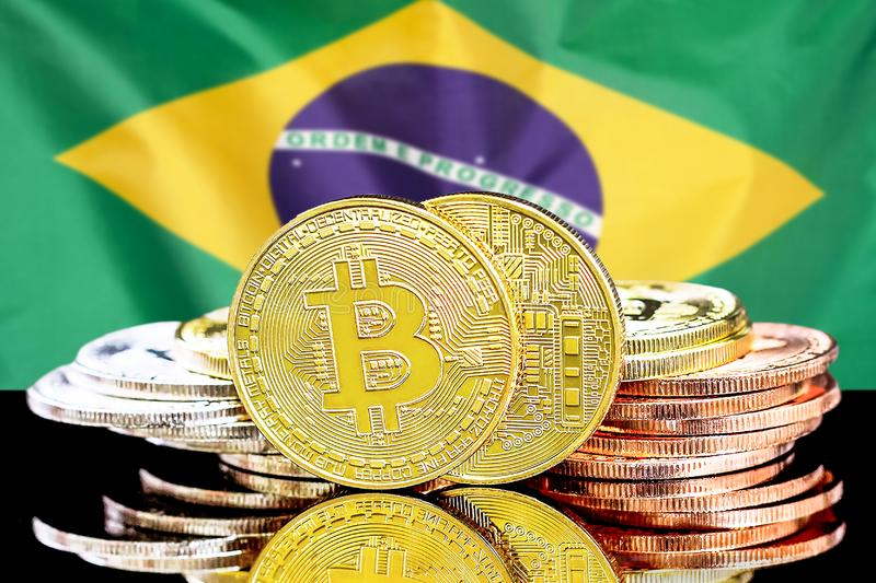 Bitcoins on Brazil flag background royalty free stock images