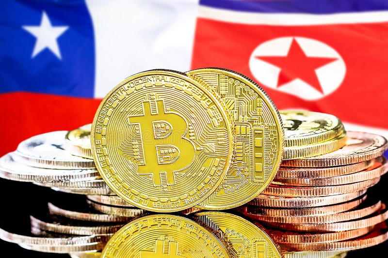 Bitcoins on Chile and North Korea flag background royalty free stock photography