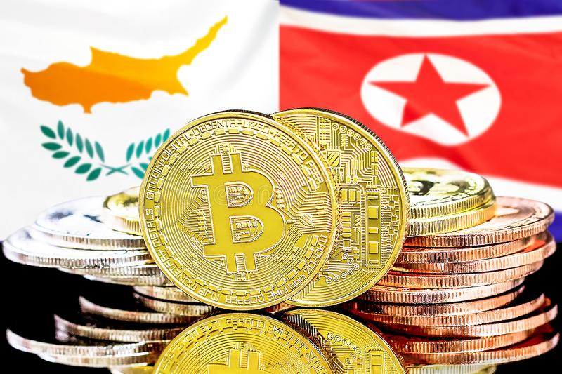 Bitcoins on Cyprus and North Korea flag background royalty free stock images